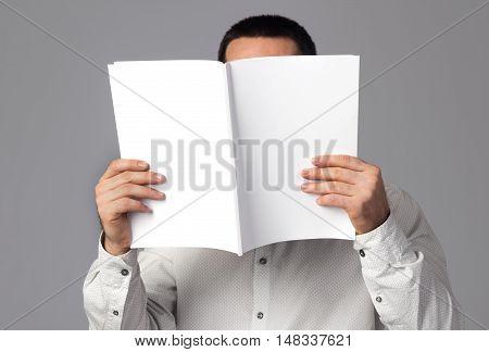 Man reading a blank magazine. Branding, brand, template, identity, design, business, envelope, print, mock-up, mock up, mockup.