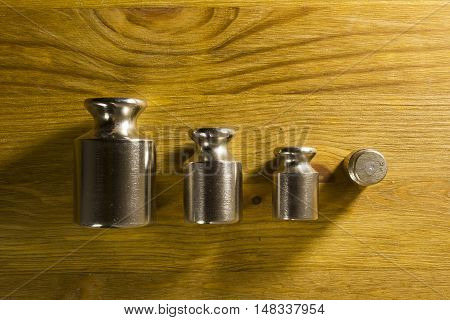 Set of precision weights for scales on a wooden background
