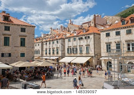 DUBROVNIK, CROATIA - JULY 20, 2016:  the very heart of Dubrovnik Old Town, the centre of Luza Square on the Stradun or Placa, the main street of Dubrovnik