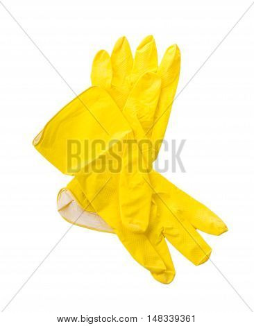 Yellow household protective rubber gloves on white