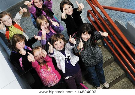 happy children group in school have fun and representing education  and teamwork concept