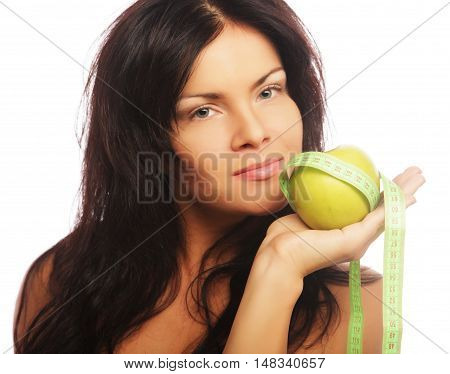 beautiful sporty woman with green apple and measuring tape isolated on white