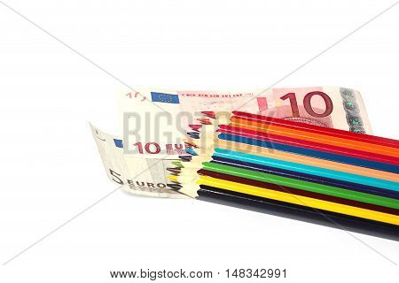 euro paper bills and a heap of colored pencils