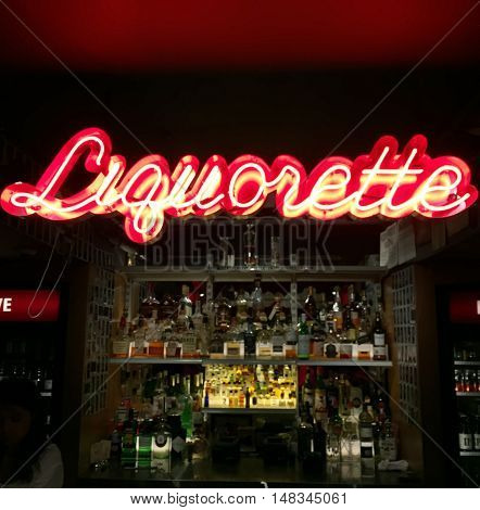 NEW YORK NY - JULY 15th 2016: Neon sign at Eben Freeman's basement bar Genuine Liquorette in Chinatown New York serving trendy drinks like the Cha-Chunker