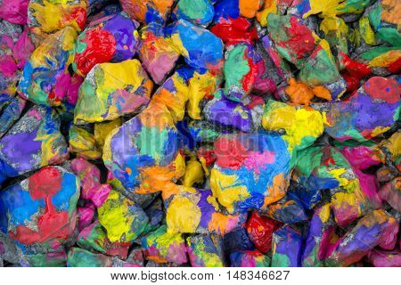 abstract background many small stones painted with colored paint. Emotional, cheerful, all colors