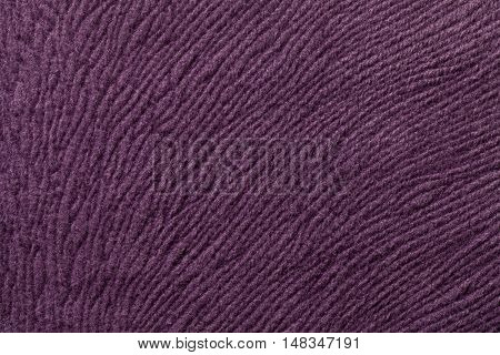 Light purple background from a soft wool textile material closeup. Fabric with natural texture. Cloth backdrop.