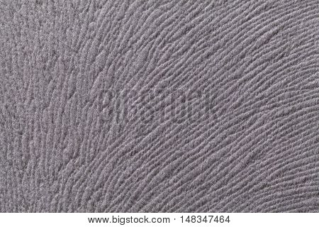 Light gray background from a soft wool textile material closeup. Fabric with natural texture. Cloth backdrop.