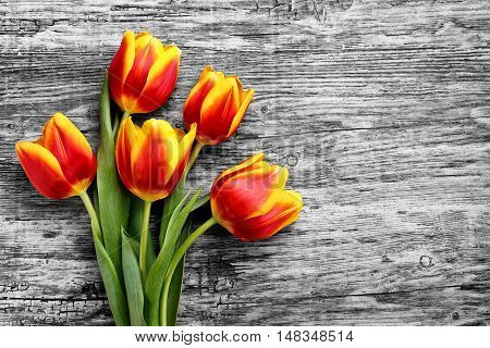 beautiful bouquet of yellow tulips wooden background, place for text.eighth festival in March