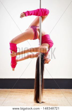beautiful young girl pole dancer takes figure