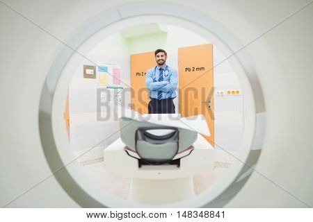 Portrait of doctor standing near mri scanner at the hospital