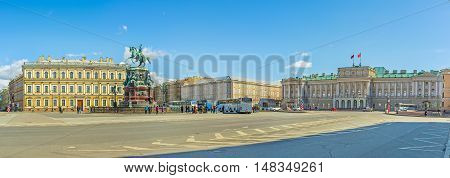 SAINT PETERSBURG RUSSIA - APRIL 25 2015: Panorama of Saint Isaac's Square with the equestrian statue of Tsar Nicholas I Vavilov Institute of Plant Industry and Mariinsky Palace on April 25 in Saint Petersburg.