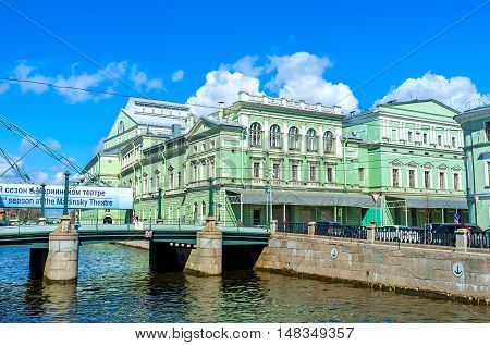 SAINT PETERSBURG RUSSIA - APRIL 25 2015: The view on Mariinsky Opera and Ballet Theater behind the Torgovy (Trade) bridge over the Krukov Canal on April 25 in Saint Petersburg.
