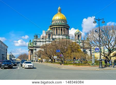 SAINT PETERSBURG RUSSIA - APRIL 25 2015: The golden domed St Isaac's Cathedral is one of the largest in the world on April 25 in Saint Petersburg.