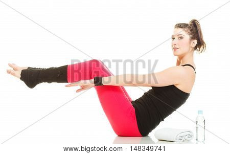 Healthy and sporty lifestyle. Fit slim girl doing stretching. Young woman exercising before sport training. Active female isolated on white.