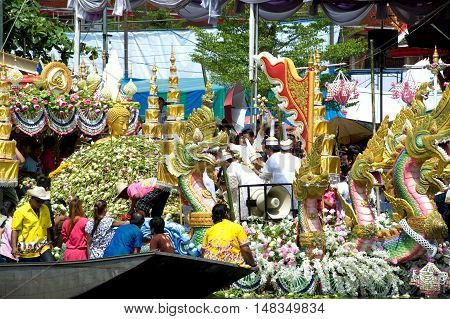 Samut Prakan, Thailand -October 10, 2011 :The Lotus throwing into the boat (Rub Bua Festival ) in Samrong canal, Bang Phli District, Samut Prakan Province, Middle of Thailand on October 10,2011. Devotees throw lotus flowers to boat procession that carry B