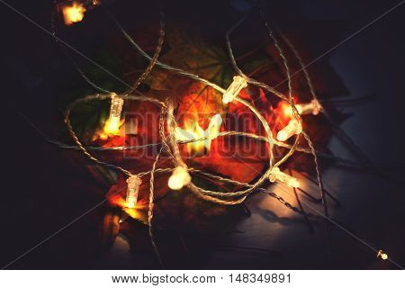 Llights garland with maple leaves. Autumn fall ceason concept