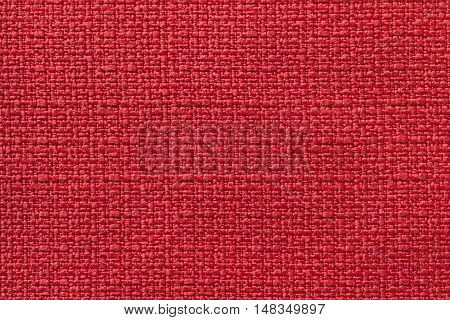 Light red background from a textile material. Fabric with natural texture. Cloth backdrop.