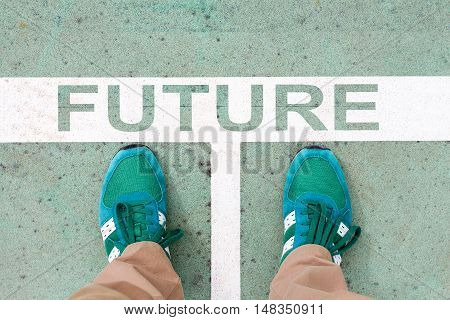 Top View of male feet on the road with white line and title FUTURE