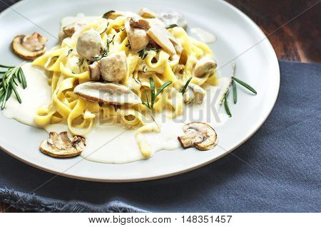 Tagliatelle vegetarian Pasta Dish with Mushrooms on the wooden background