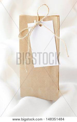 Package of kraft paper with tag for recording on a soft white blanket