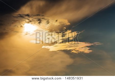 golden sunset with sun clouds over clouds. Spring sun scene. Dusk sky with sun hiding in clouds. Spring sun over clouds