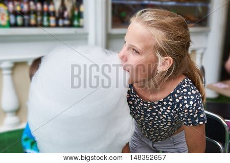 The girl eating a big cotton candy