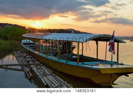 the boat with sunset at chaing kran .