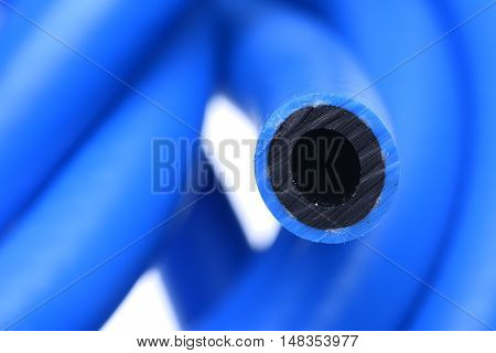 Blue pressure hose on isolated white background