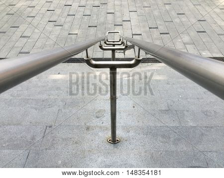 High angle view of metal handrail and pavement