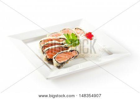 Nori Wrapped Salmon. Garnished with Daikon