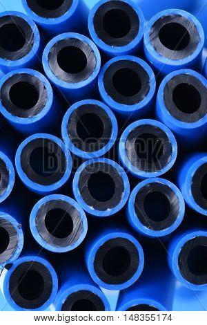 Pressure hoses blue hydraulic pipes closeup closeup