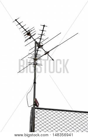 TV and communication aerials on roof of residential house, isolated antennas and dish