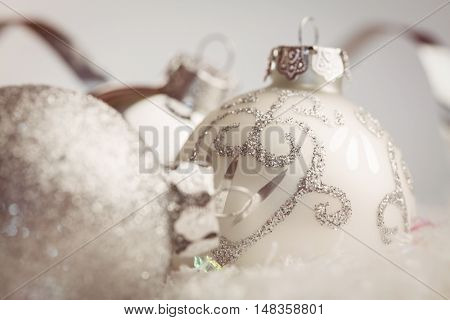 extreme close up view of white baubles against white background