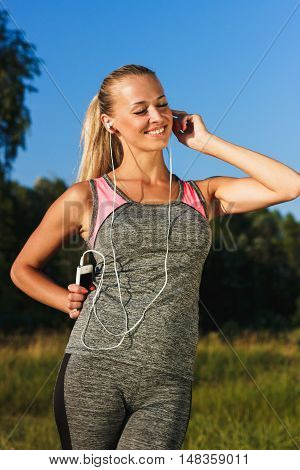 Young Sporty And Attractive Woman Listening To Music