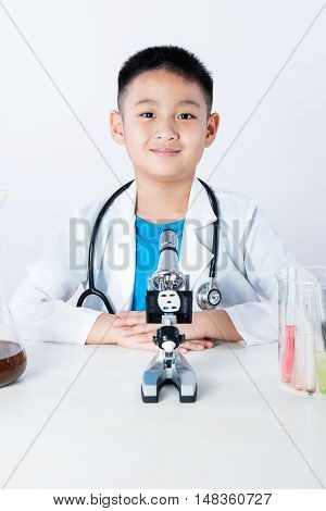 Asian Chinese Boy Working With Microscope