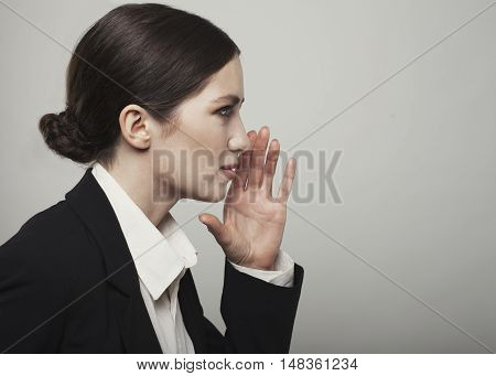Portrait Of A Speaking Young Woman Isolated