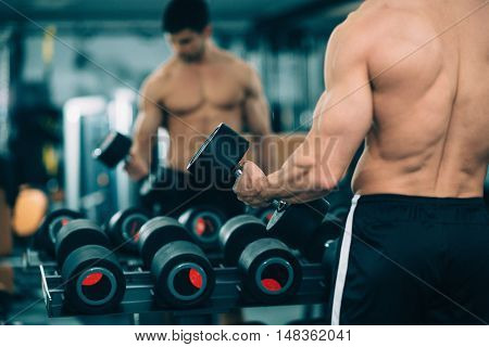 Gym Workout - Male Athlete Exercising In The Gym