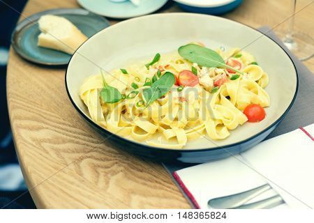 Crab fettuccine in outdoor restaurant