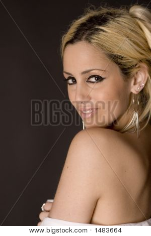 Smiling Profile Of Blond Model With Bare Shoulder