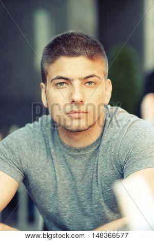 Young man in outdoor restaurant