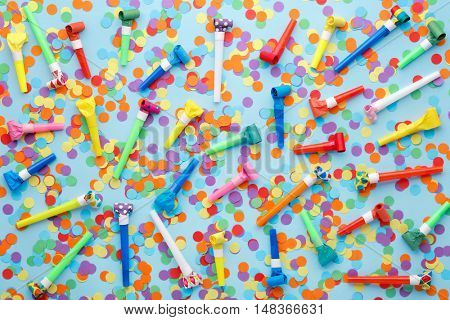 Party decoration,Confettis and whistles on blue background
