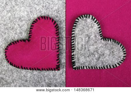 two felt heart on a on a two-color background