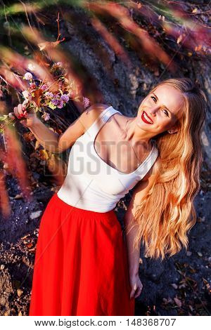 girl fall long hair autumn red orange leaves branches mood smiling delight