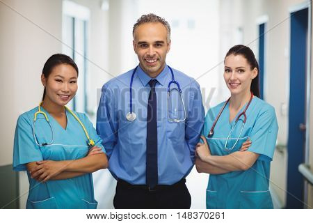 Portrait of doctor and nurses standing with arms crossed at the hospital