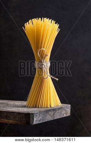 Bunch of spaghetti on a wooden board