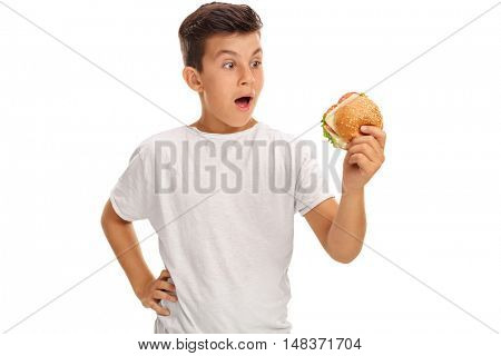 Small boy admiring a sandwich isolated on white background