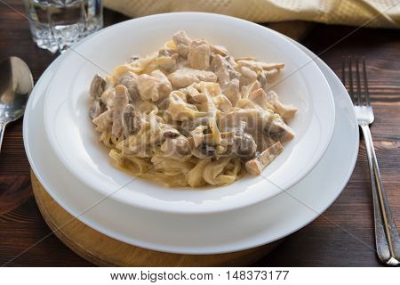 Italian pasta spaghetti with chicken and mushrooms