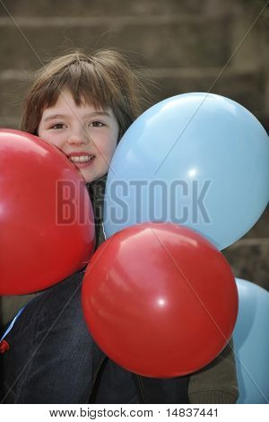 happy young girl with balloons outdoor
