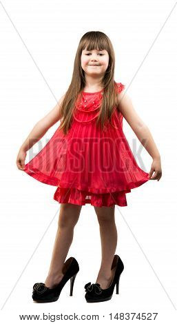 little girl in her mother's shoes on a white background