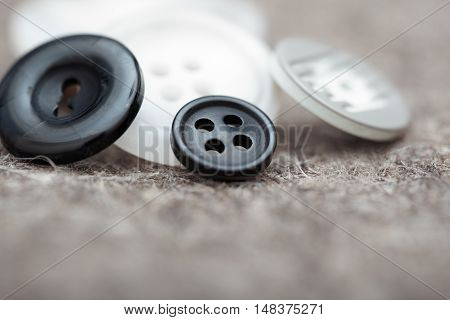 Black and white buttons. Extremely close-up photo with shallow depth of field